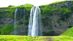 Seljalandsfoss waterfall, one of the biggest waterfalls in Iceland drop of 60 m  Stock Footage