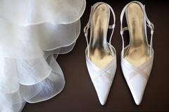 Shoes with wedding dress Stock Photos