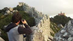 Panorama of photographer at fortress of castle sintra, slow motion dolly Stock Footage