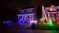 Panning time lapse video of Suburban house heavily decorated with lights and inf Stock Footage