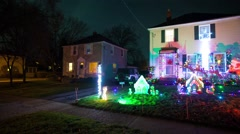 Panning time lapse video of Suburban house heavily decorated with lights and inf - stock footage