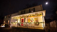 Panning time lapse video of Suburban house decorated with lights for Christmas - stock footage