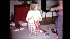 Little Girl Opens Christmas Stocking Xmas 1970s Vintage Film Home Movie 9058 Stock Footage