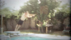 1963: Athletic man does full forward flip into residential pool. SAN DIEGO, - stock footage