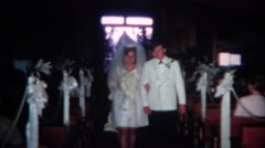 1966: Young couple walking down wedding aisle and kissing at altar.  CINCINNATI, Stock Footage
