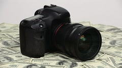 Dslr camera and money Stock Footage
