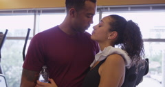 4k black and Hispanic couple man and woman kissing in gym after working out Arkistovideo