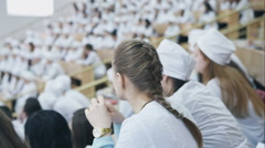 Medical University Students listening a lecturer in lecture halls - stock footage