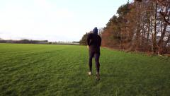 A man running and training on grass field - stock footage