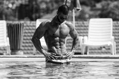 Perfect Abs In A Pool Spa Outdoors - stock photo