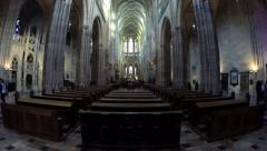 Inside Saint Vitus Cathedral camera pan to right showing wooden banks 4k Stock Footage