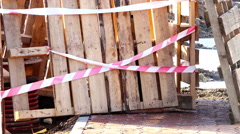 Fenced playground area during the construction of a residential complex - stock footage