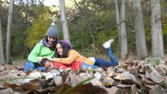 Three children play sitting in autumn park leafs Stock Footage