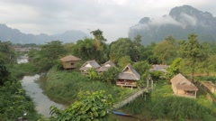 Tourist bungalows and karst mountains early morning,Vang Vieng,Laos Stock Footage