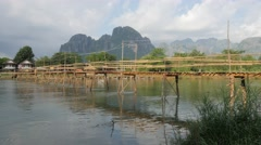Motorcycle crossing bamboo bridge,Vang Vieng,Laos Stock Footage