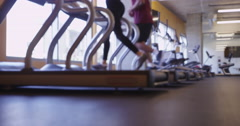 4k Out of focus blurry Hispanic and Black couple running together on treadmills Stock Footage