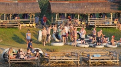 Young western tourists partying after tubing,Vang Vieng,Laos Stock Footage