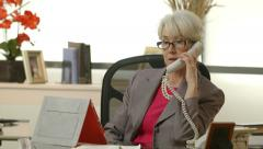 Businesswoman checking her tablet pc and answers phone Stock Footage