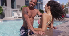 4k Slow mo Happy loving romantic multi-ethnic couple embracing in pool - stock footage