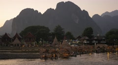 Tourists in river bar in evening,Vang Vieng,Laos Stock Footage