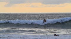 Surfing in the Pacific of Costa Rica,two - stock footage