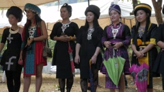 Traditional dressed girls do ball throwing game,Vang Vieng,Laos Stock Footage