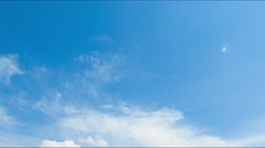 Clouds moving across the blue sky Stock Footage