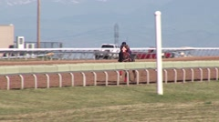 Stock Video Footage of Horses Racing at the Track