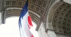 Stock Video Footage of Triumphal Arch and French Flag - Paris, France, Arc de Triomphe Paris, France