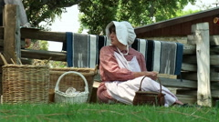 1870 Woman Sits with Baskets Stock Footage