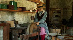 1870s Woman Works Grinder in Blacksmith Shop Stock Footage