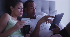4k Black and Hispanic couple making online purchase with tablet computer Stock Footage