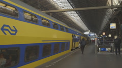 Intercity train departing from Amsterdam Centraal - ungraded: c-log Stock Footage