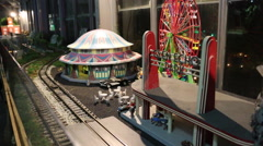 Model Train Ferris Wheel and Carousell Medium Shot Stock Footage