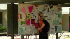 Student Views Bulletin Board CU Stock Footage