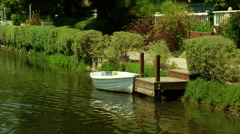 Small Row Boat at Dock - stock footage