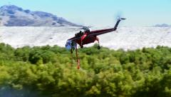 Skycrane Helicopter Leaves Dam 2 Stock Footage