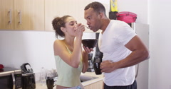 4k Hispanic girlfriend sharing breakfast with Black boyfriend while standing in Stock Footage