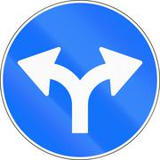 Road sign used in Switzerland - Turn right or left - stock illustration