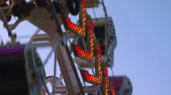 Carnival Thrill Ride Zipper Close Med Shot Stock Footage
