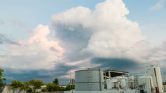 Timelapse strom over oil tank - stock footage