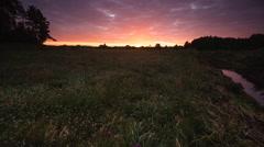 Beautiful sunrise over meadow. Full HD RAW video Stock Footage