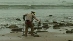 Man w Metal Detector 002 Stock Footage