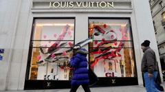 Louis Vuitton Luxury Store, Paris, France establishing shot - stock footage