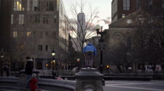 Boy and girl look at Freedom Tower from Washington Square Park in early evening Stock Footage