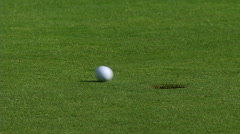 Golf Ball in Cup ECU Stock Footage