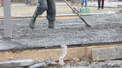 Concrete worker aligns a special device Stock Footage