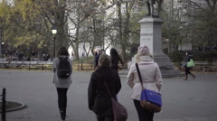 Famous Garibaldi statue in Washington Square Park, tilting up from students NYC Stock Footage