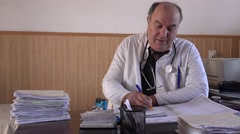 Busy adult man doctor at the office smiling medic happy person, healthcare place - stock footage