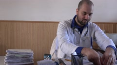 Stock Video Footage of Modern young doctor examining medical vial, treatment solution expertise, advice